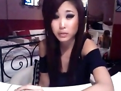 Asian cambabe smoking and teasing. More at 747cams.com