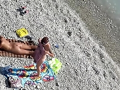Spying two minority on the beach hot amateur