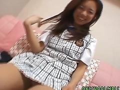 Japanese cutie gets vibrator in her pussy to the fore giving amazing blowjob