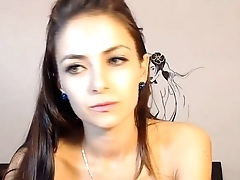 Hot young babe dancing, sucking and masturbating in the lead of a webcam