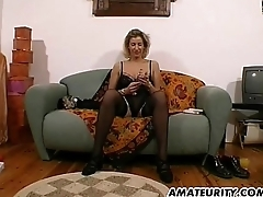 Amateur Milf toys and strokes a dig up with reference to cum on tits