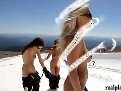 Badass babes snowboarding while all nude