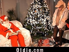 Old Santa punishes a nasty girl